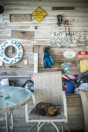 """Paraphernalia outside Whiddon's Marina hints at more """"treasure"""" inside their Maritime Museum. Photo by Liz Pasch"""