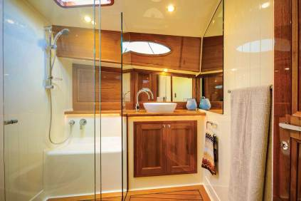 Palm Beach 65 Ensuite heads come with enclosed showers and contemporary fixtures. Photo credit: Andrea Francolini