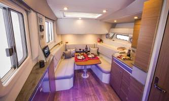 """Woodgrain-finish flooring, windows that open, wise use of space, and 6' 6"""" headroom in the cabin offer an upscale experience."""