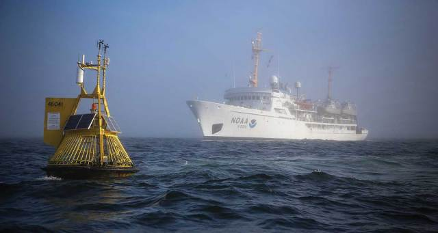 The NOAA vessel Fairweather approaches one of many data buoys, which provide real-time information critical for understanding and predicting El Niño and La Niña events, ocean currents, rogue waves, and more. photo courtesy of NOAA