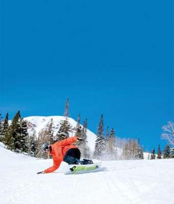 Snowboarder-on-Groomer in Park City Utah