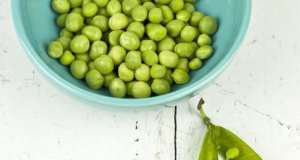 An image of a bowl of peas before they are added to Sweet Peas and Onions.