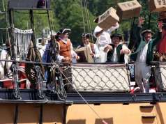 Actors reenact the Boston Tea Part at the Chestertown Tea Party Festival.