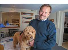 yacht designer Doug Zurn with his dog