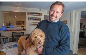 yacht designer Doug Zurn with his dog