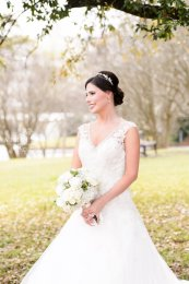 Happy Bride in Garden With Bouquet