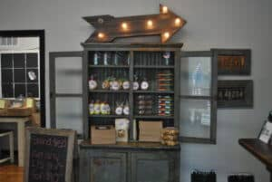 Rustic cabinet full of goodies from Hey Sugar Shop