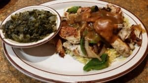 Chicken Tips over Rice with a side of Turnip Greens