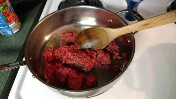 adding Hamburger to frying pa