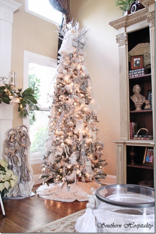 and last she added some silver shiny picks that stick in the tree and flow downward - How To Decorate A White And Silver Christmas Tree
