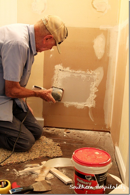 dad patching wall