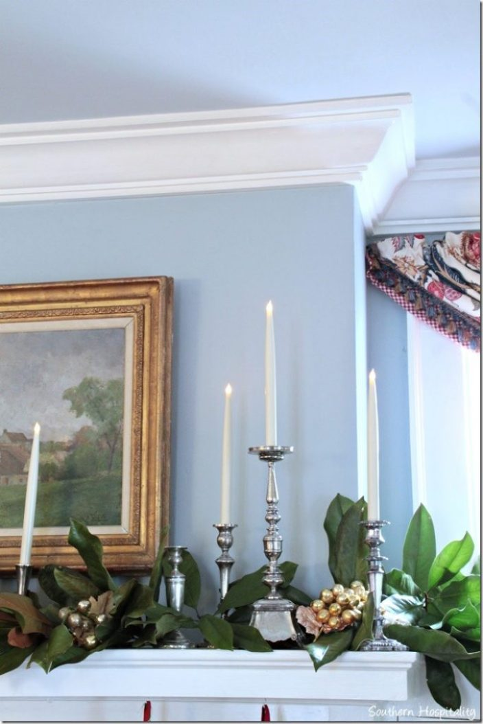 candles and greens on mantel