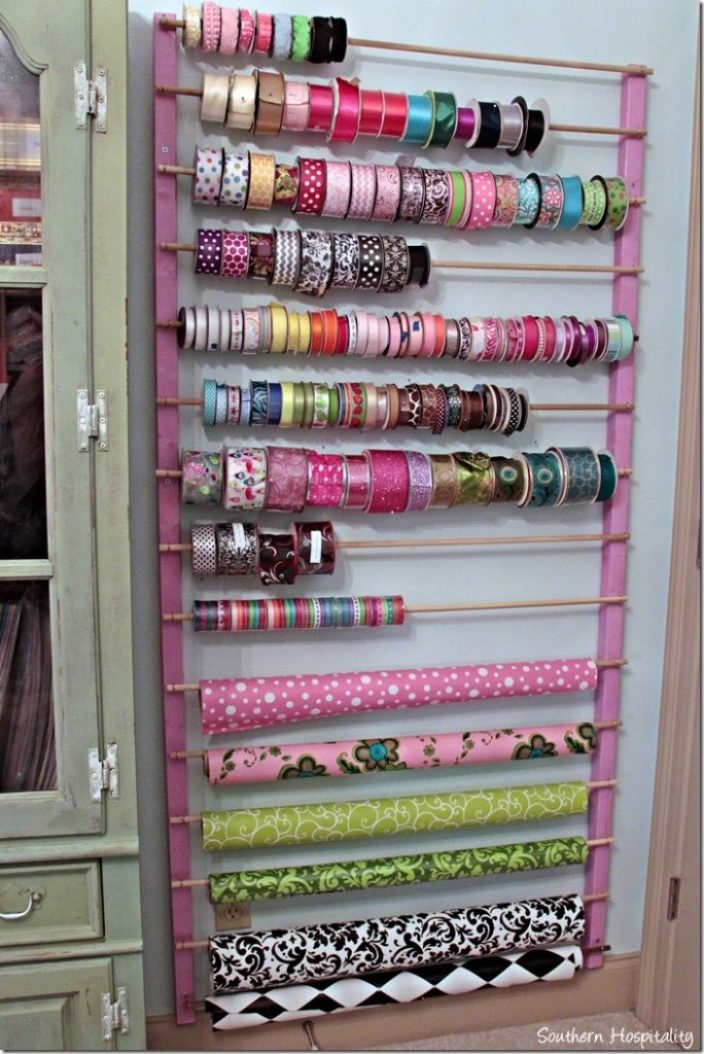 wrapping paper storage idea by southern hospitality