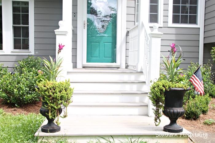 front door with urns