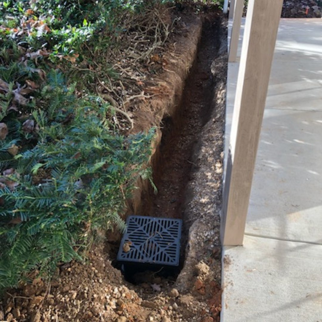 Installing Drain During Waterproofing Project
