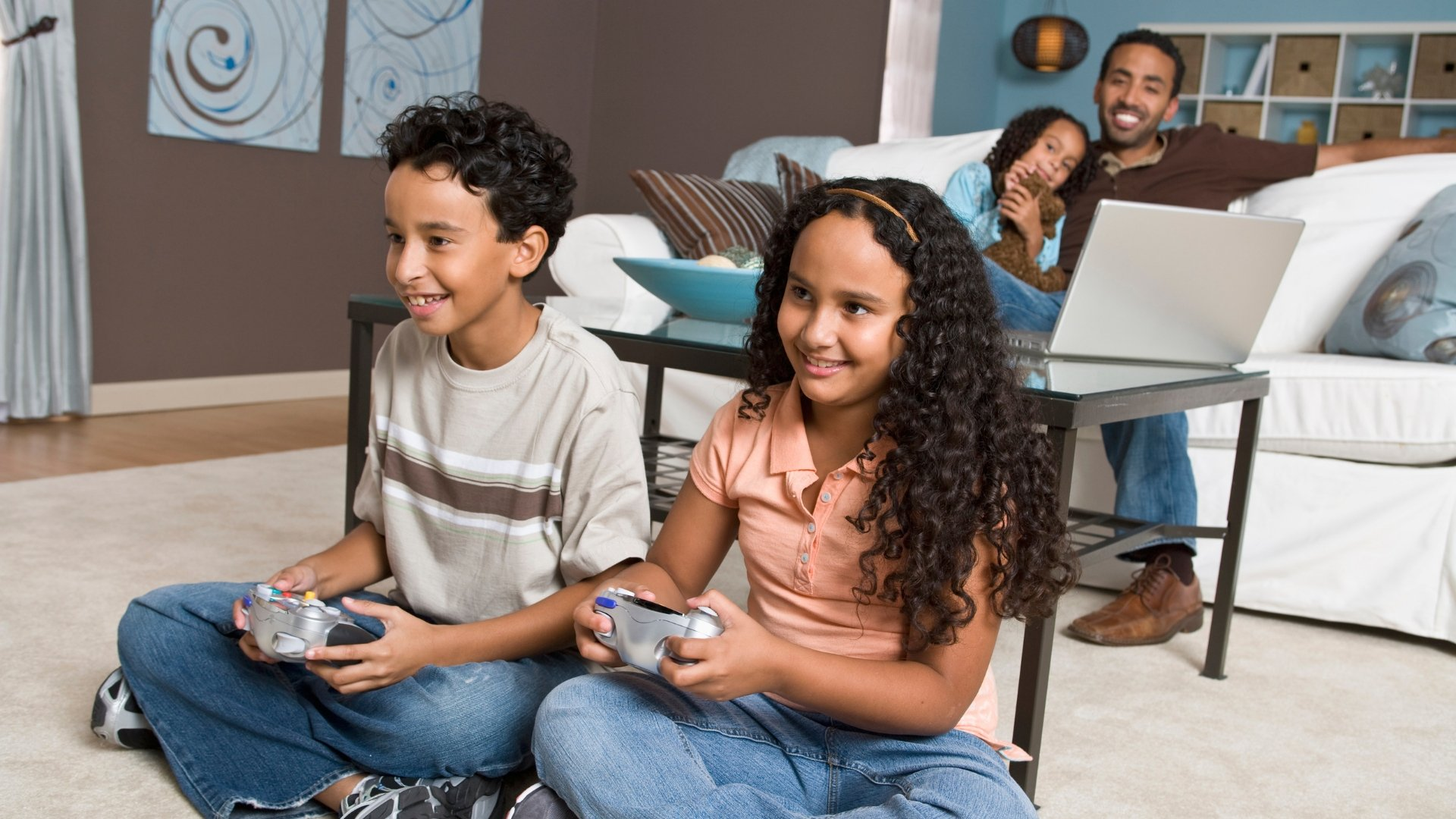 Kids Playing Video Games While Parents Relax on Couch