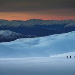 From near Bob Lee hut at the Snow Farm NZ. Criffel Range to the right behind the people - NZ's highest altitude historic gold diggings.