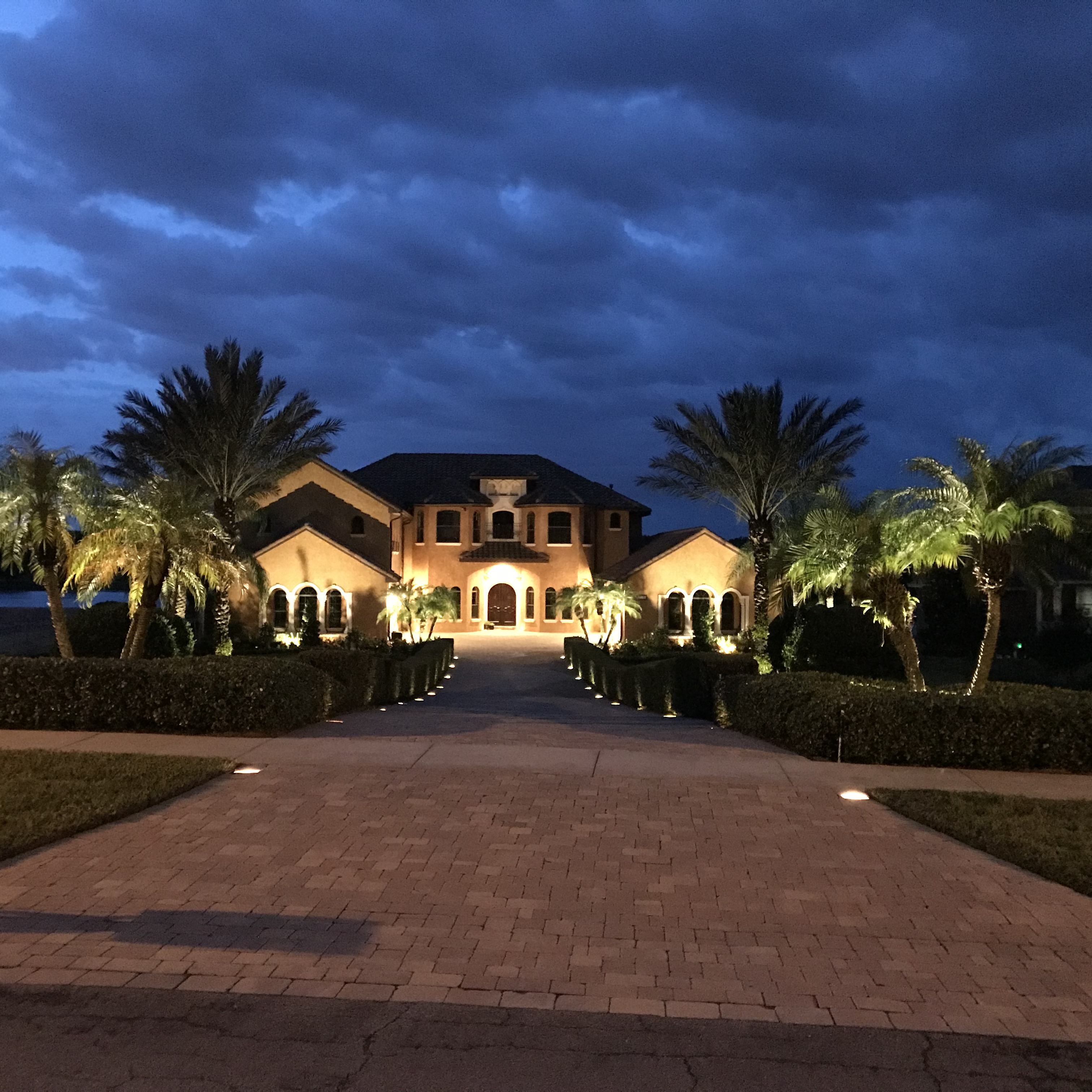 view of entire house and lighting lining the driveway