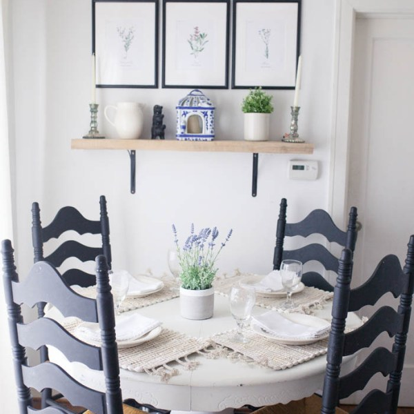 Kitchen Nook Reveal and Neutral Summer Tablescape from brittany at SouthernMamaGuide.com || white kitchen || herb prints || blue and white || chinoiserie || country kitchen || country style || fixer upper || summer place setting || tables cape || pottery barn dishes || home goods || faux lavender || white linen