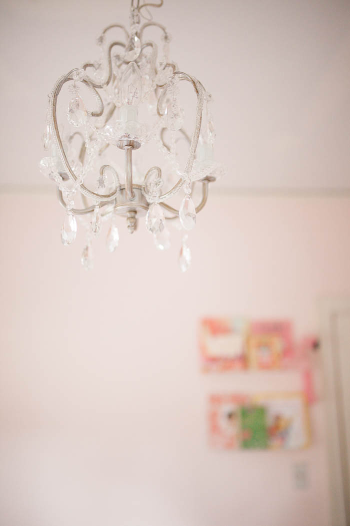 Scarlett's Sneak Peek Floral and Pink Gingham Room Reveal by Britt at SouthernMamaGuide.com | The Shade Store | Carousel Designs | Floral bedding | Toddler Girl Room | Pink Bedroom | Benjamin Moore | Amalfi Decor | Acrylic Shelves | Roman Shades | Black Out Curtains | Pink Gingham