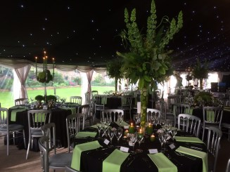 Lime green napkins complimented the stunning flower displays in this wedding marquee.