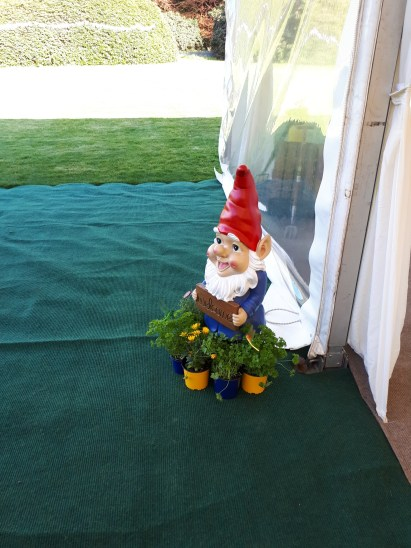 A gnome welcomes the guest to this original English Country Garden themed wedding at Hollybank House.