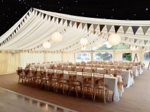 Another picnic style wedding complete with bunting, simple paper lanterns and trestle tables.
