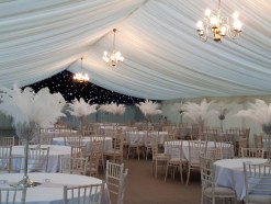 What a contrast the starlight roof linings make in this stunning wedding marquee.