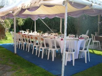 An Easter lunch party in a garden with shade from the spring sunshine!