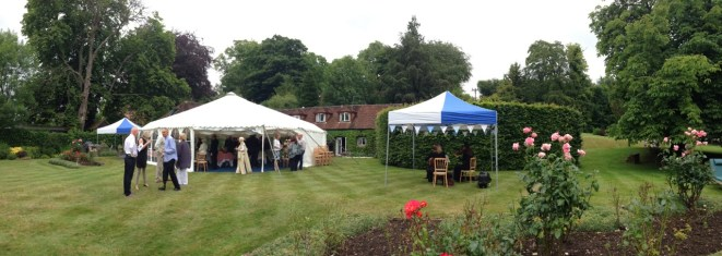 This lovely garden party with the walls rolled up so the guests can spill onto the garden.