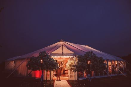 A beautiful warm welcoming glow is given off by this pretty AMH wedding marquee ...