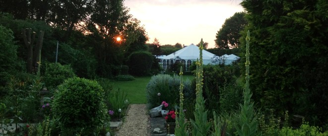 The beautiful shape of our AMH marquees nestle into the garden.