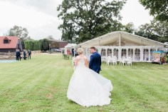The bride and groom arrive at the marquee ready to celebrate with their family and friends.