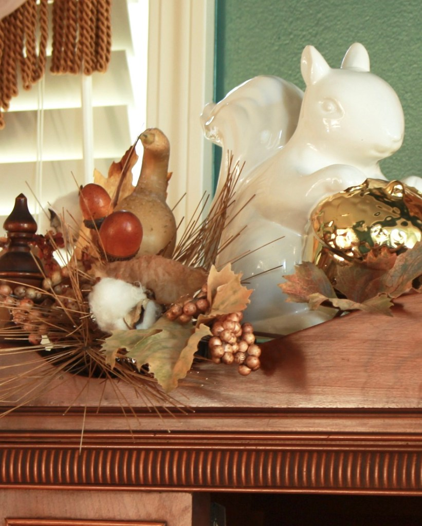 Ceramic Squirrel surrounded by fall foliage