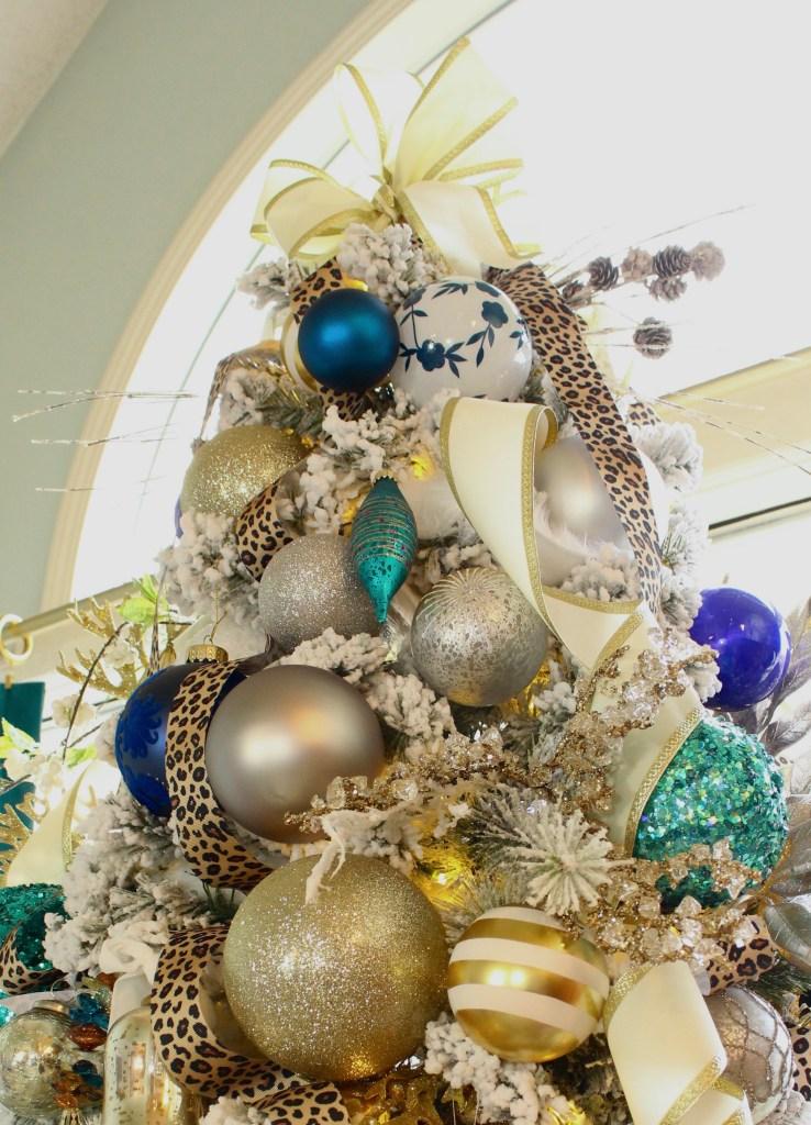 Ivory Velvet Ribbon tied to the top of an Elegant Flocked Christmas Tree