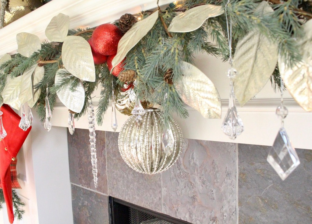 Large Mercury Glass Ornament and Silver Magnolia Leaves on Christmas Mantel