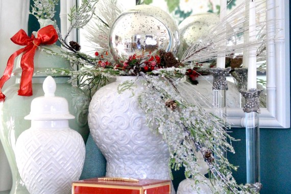 White ginger jars with red christmas bow and icy branches