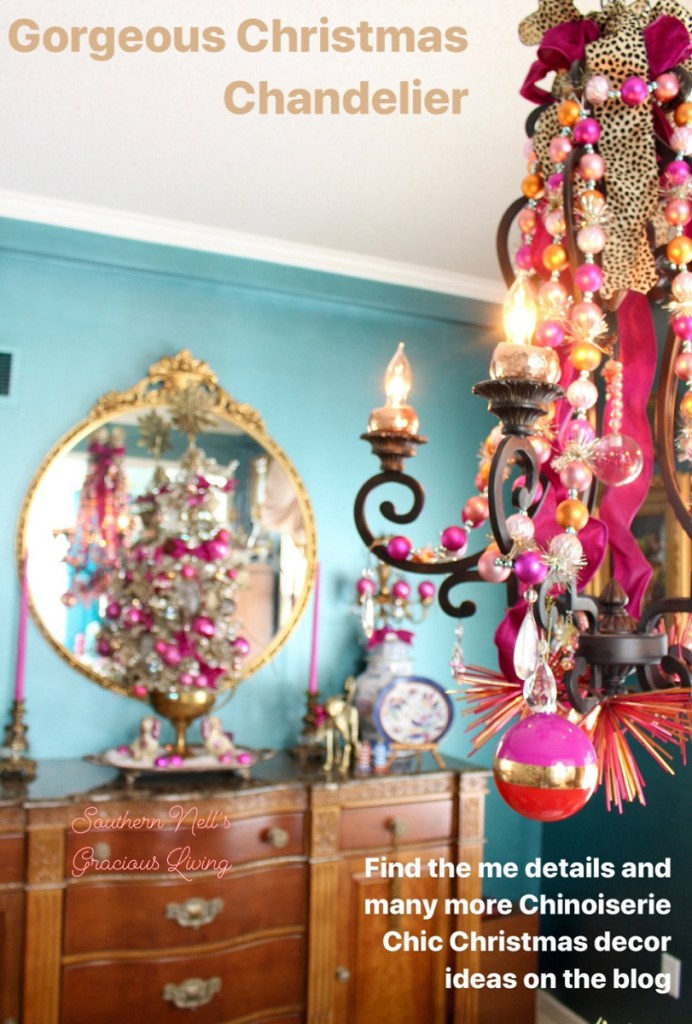 Chandelier with Garland and Brass Antique Mirror in backround