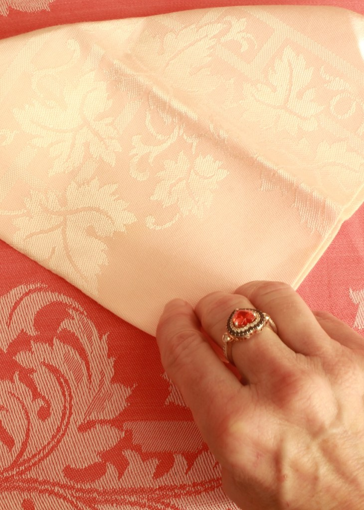 Hand folding Pink Napkin