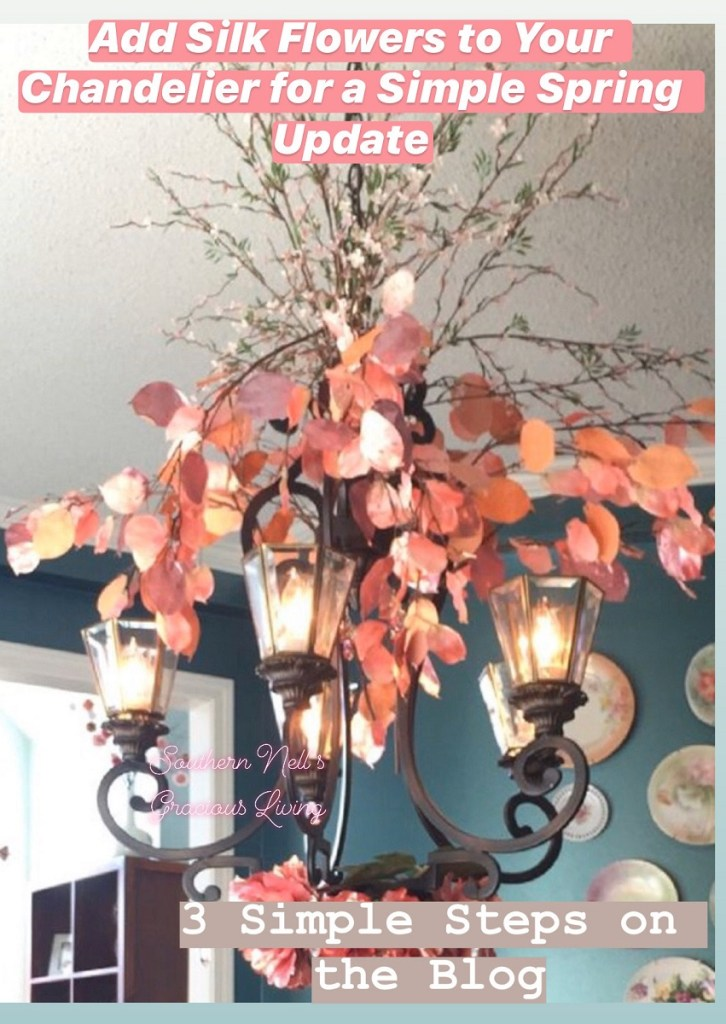 Coral colored faux spring florals on wrought iron chandelier