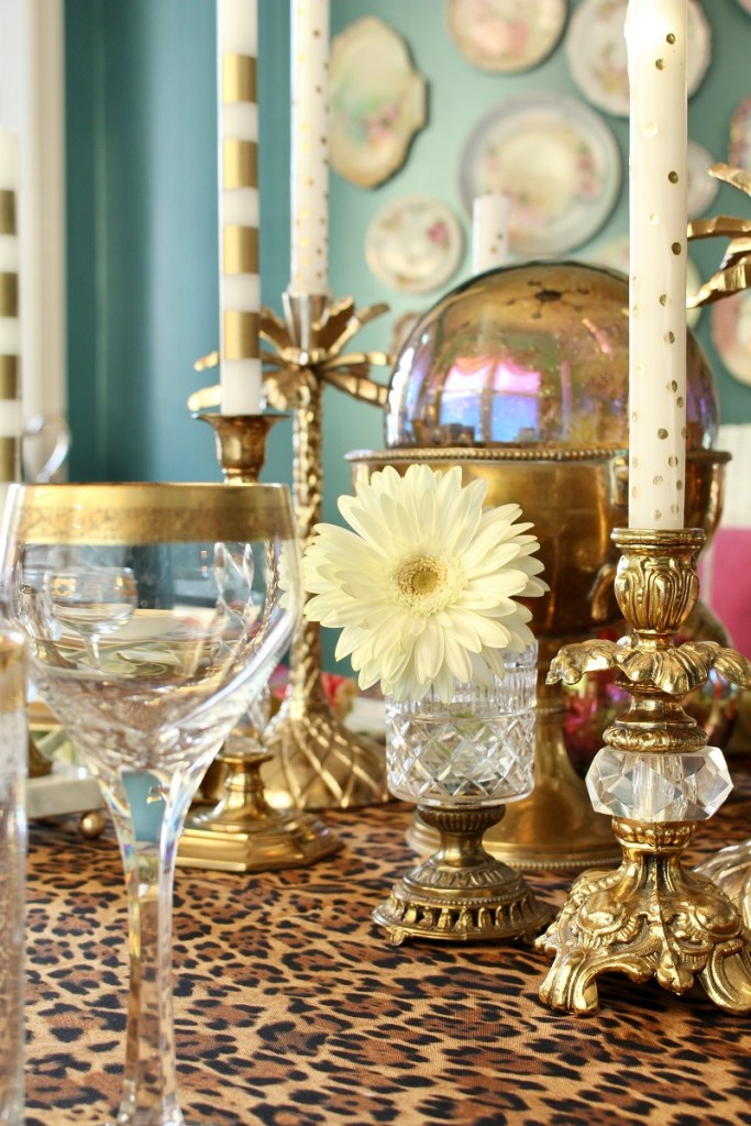 Cheetah print tablecloth and vintage brass candlesticks