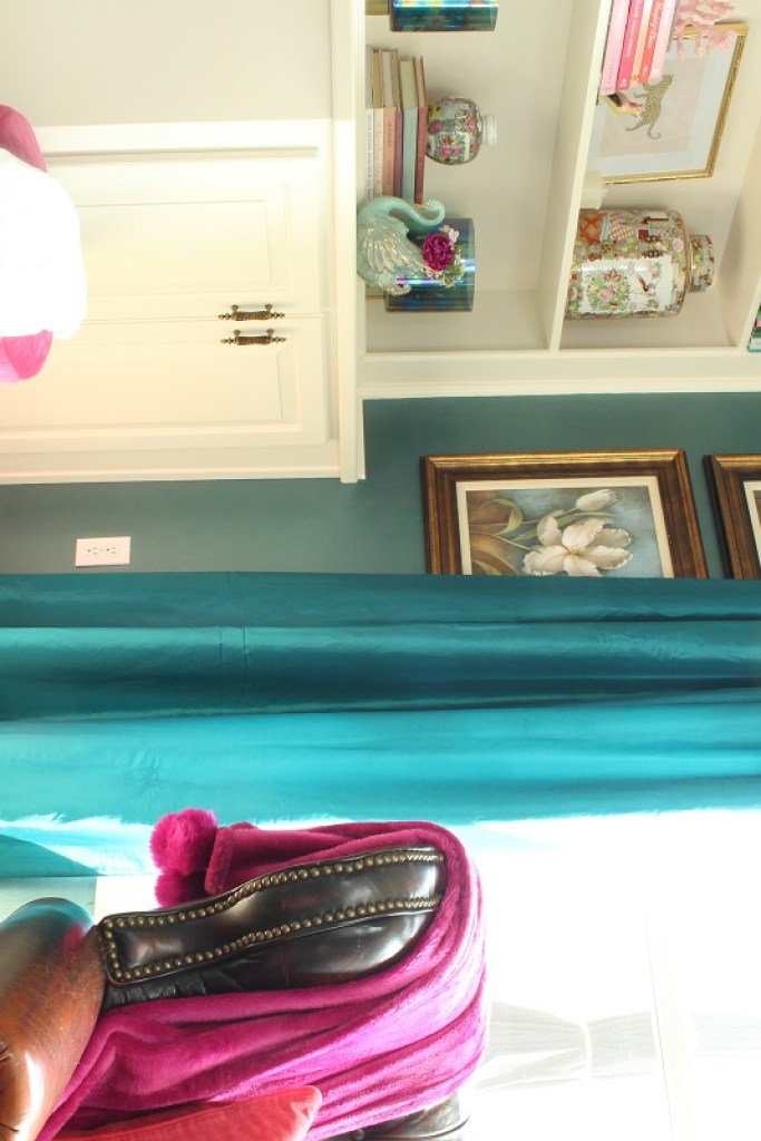 Turquoise Drapes beside a white bookcase