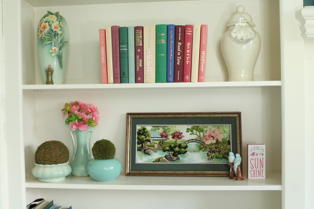 Bookshelf with books and art