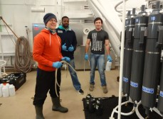 Johan, Ismael and Ian (all MSc or PhD students from Stellenbosch University) ready to collect water from the Niskin bottles