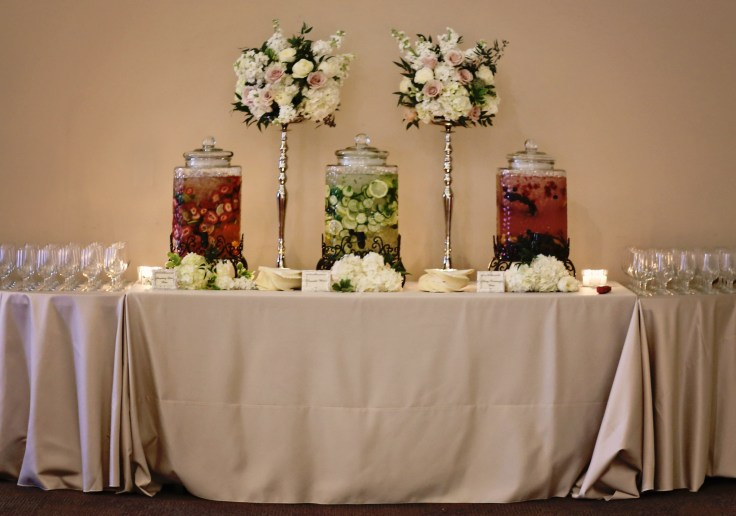 beverage station | ivory and blush centerpiece on silver stands | wedding florist southern productions weddings & events meridian ms