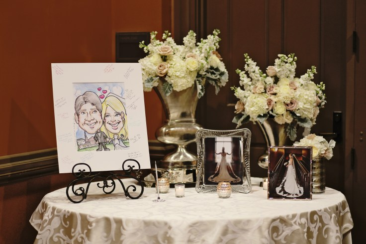 blush roses white hydrangea white stock and dusty miller centerpiece | caricature art guest book | the riley center