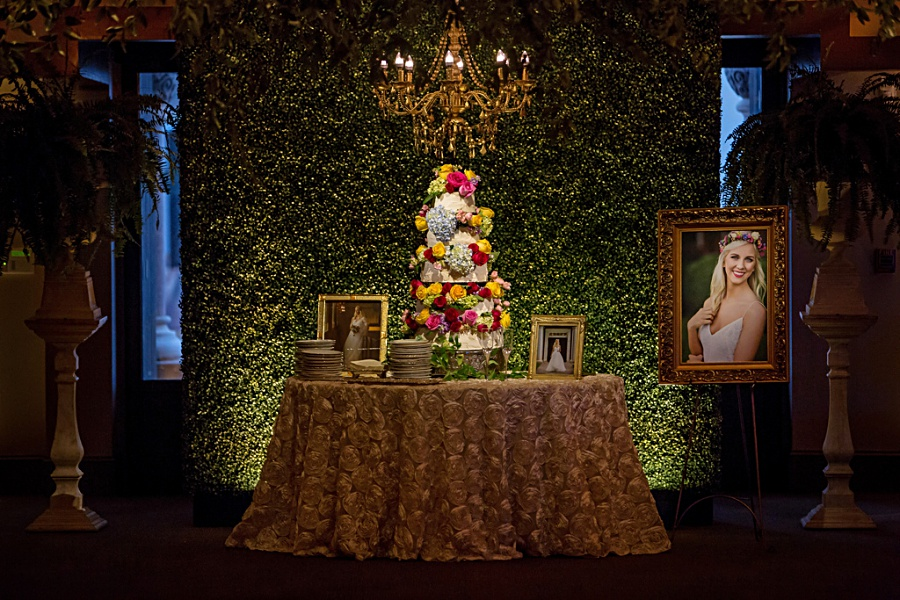 Boxwood Wedding Cake Backdrop at Boho Mississippi Wedding