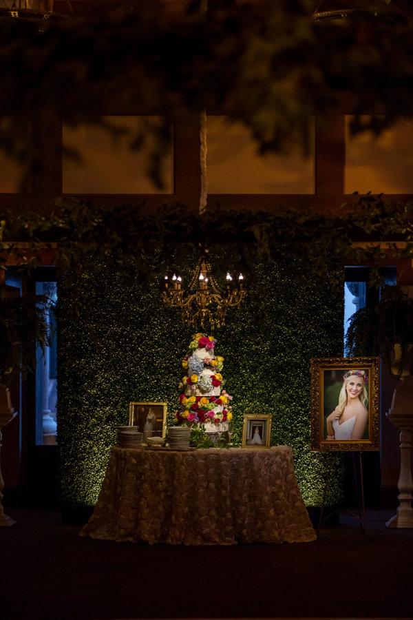greenery backdrop   wedding cake backdrop   boxwood backdrop   msu riley center wedding