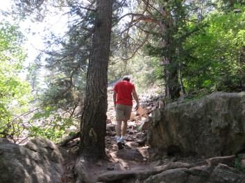 David hikes a rocky trail