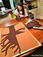 Anna Marie works on the tree